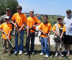 Kids holding hunting rifles