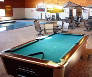 pool table in a pool room